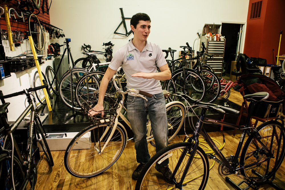 No to the cruising bike, despite my love of picnic baskets. But the purple Giant Escape 2W On-road Sport Fitness bike in front of Dan? Could be the perfect...